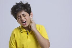 boy ear ache pain sore healthcare gp appointment